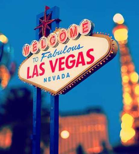 Bright lights of Sin City surround the Welcome To Las Vegas sign. Discover Las Vegas Hen P